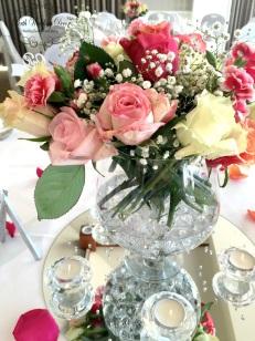 Anna & Hong. $35.00 each including fresh flower arrangment