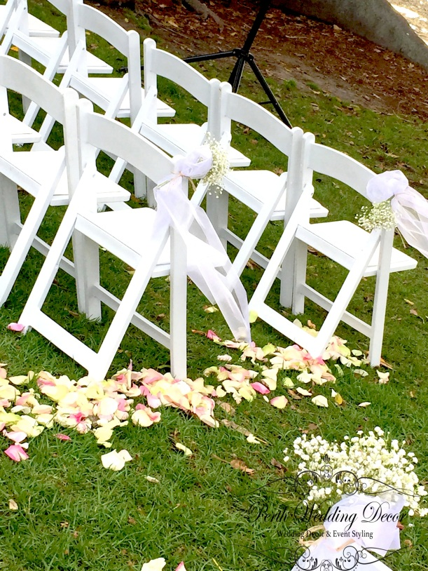 Baby's breath tied in a sash on the aisle chairs. $4.50 each.