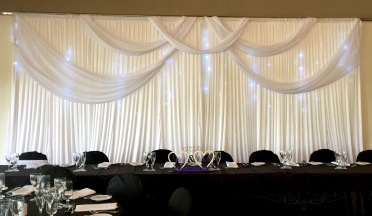 Backdrop with material feature and lights. 1-3m $175, 3-6m $250, 6-12m $280