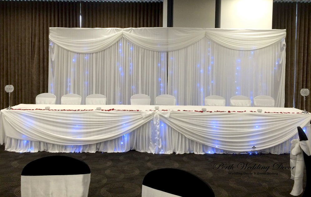 Backdrop with swagging and lights. 1-3m $150, 3-6m $200, 6-12m $250