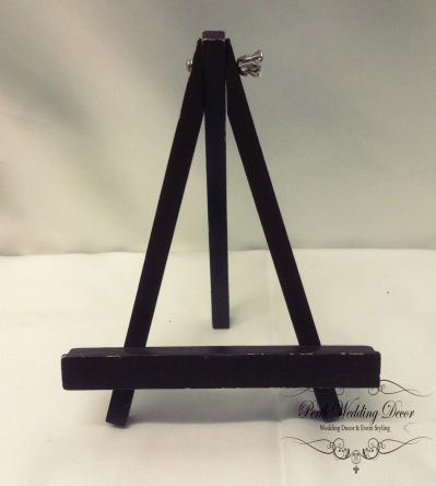 Black wooden small easle. $0.50 each