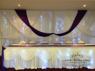 Bridal table skirting with mini draping and fairy lights. 3m-6m $18.00, 6m-12m $24.00