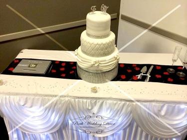 Cake table skirting, draping & fairy lights. $18.00