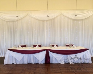 coloured draping at front of table. 3m-6m $ 12.00, 6m-12m $20.00