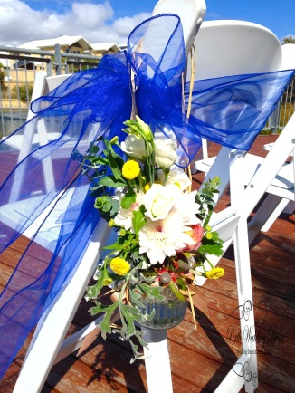 Coloured sash with large flower arrangment in hanging jar. $4.50 each