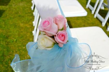 Coloured sash with silk flowers. $1.75 each