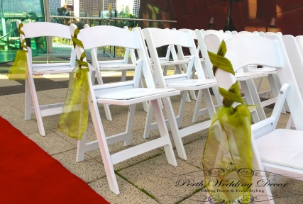 Criss cross sashes on the aisle chairs to add a bit of colour. $1.00 each