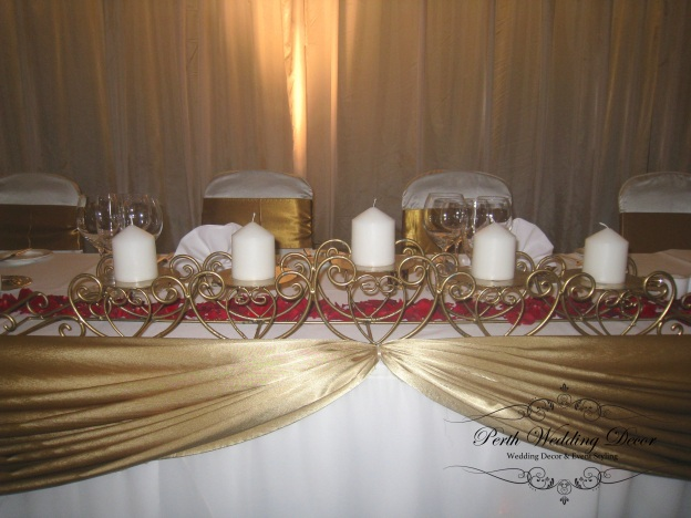 Gold 5 arm candelabra with 5 pillar candles. $38.00