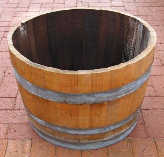 Half wine barrel. $50.00 each