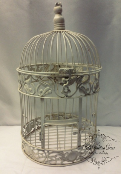 Ivory birdcage slight rustic feel. $12.50 each