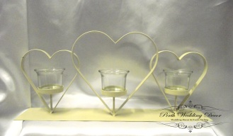 Ivory metal 2 heart stand with candle holder. $8.00 each