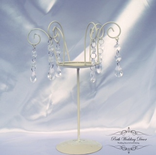 Ivory metal candle stand with crystal features. $5.50 each