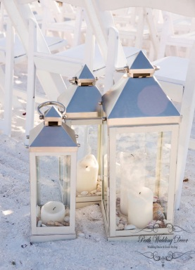 Lantern with sand, shells and candles. $3.50 per set of 3