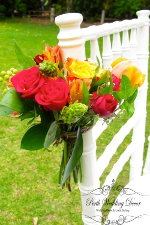 Large colourful flower arrangment on aisle chairs. $4.50 each
