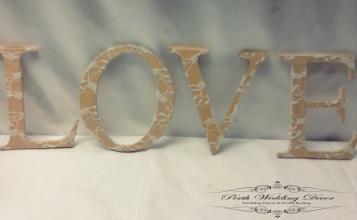 Lave LOVE wooden letters. $2.00 per set