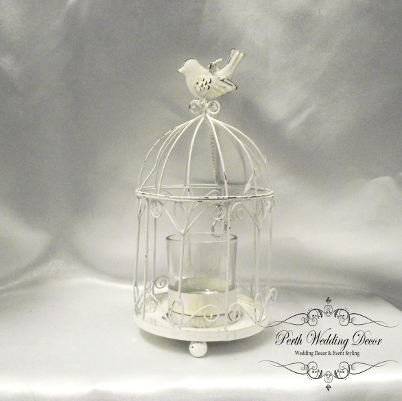 Mini birdcage with a tea light candle in the middle. $2.00 each