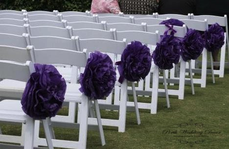 Paper pom poms on aisle chairs. $1.00 each