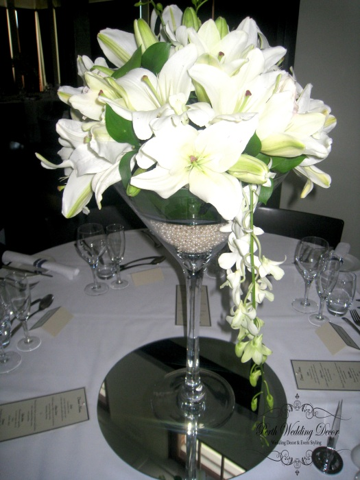 Sally & Jon. $35.00 each including silk flower arrangment
