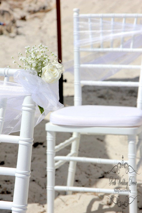 Sash with babies breath and fresh roses on aisle chairs. $2.00 each
