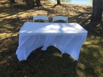 Signing table with cloth and skirting. $18.00