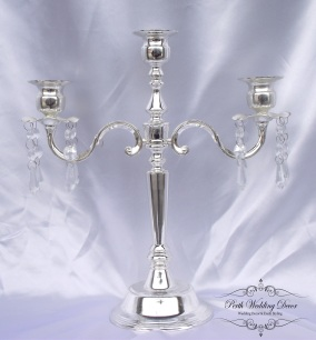 silver 3 arm candelabra with crystal drops. $15.00 each