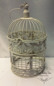 Small round ivory birdcage, slight rustic feel. $5.50 each