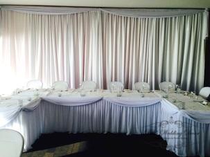 U shape table with skirting and draping. $24.00