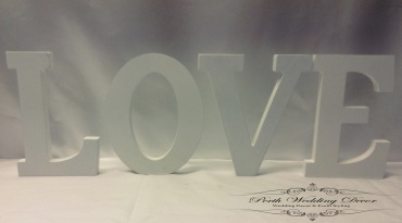 White LOVE wooden letters. $2.00 each