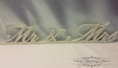 White mr and mrs wooden sign. $2.00 each