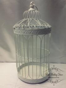 White tall birdcage. $17.00 each