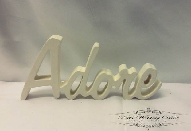 White wooden word, Adore. $1.00 each
