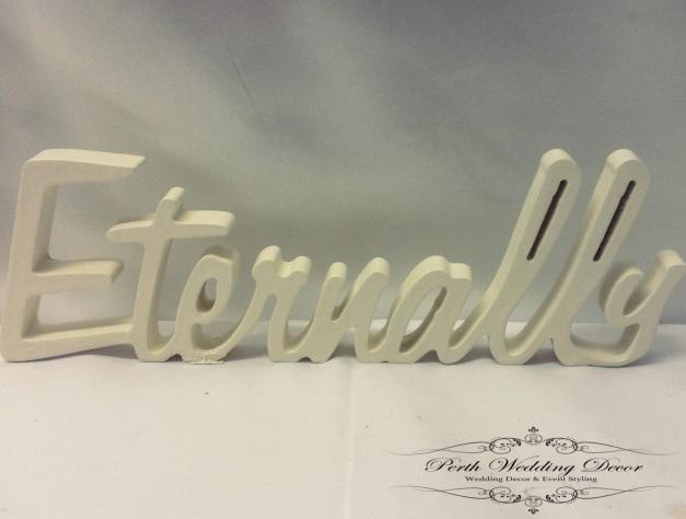 White wooden word, Eternally. $1.00 each