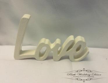 White wooden word, Love. $1.00 each