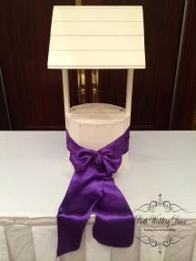 Wishing well with coloured sash