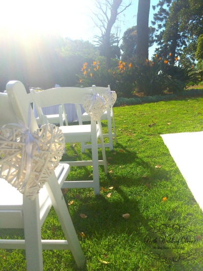 Wooden hearts hanging on aisle chairs. $1.00 each