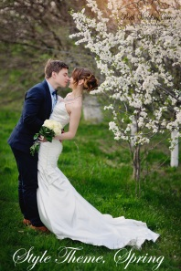 bride and groom walking in the blossoming spring garden